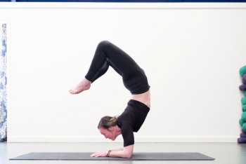woman doing a hand-stand pose