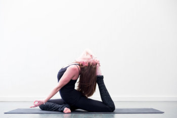 woman doing yoga pose on the floor